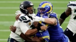 Seattle Seahawks quarterback Russell Wilson (3) is tackled by two against the Los Angeles Rams defenders during the second half of an NFL football game Sunday, Nov. 15, 2020, in Inglewood, Calif. (AP Photo/Jae C. Hong )