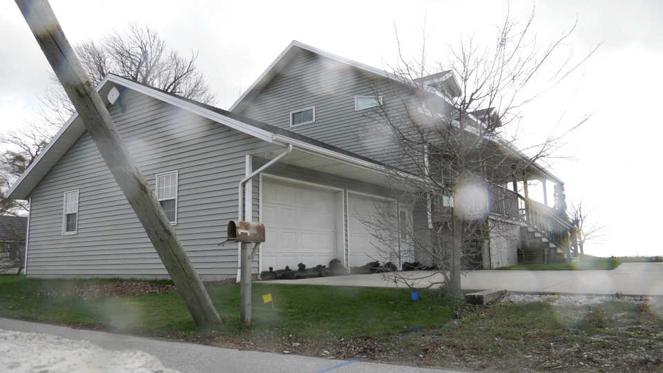 Stephanie Bourdreau's home was sparred significant flooding or damage after a significant wind storm blowed through Erie Shore Drive near Erieau in Chatham-Kent on Sunday, toppling hydro poles and destroying at least one home. Monday, November 16, 2020. (Ricardo Veneza/CTV Windsor).