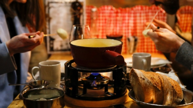 Image of article 'Swiss cheesed off over COVID-19 threat to fondue conviviality'
