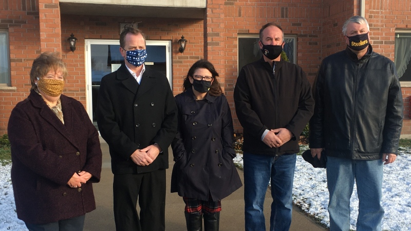 From left, Aylmer Mayor Mary French, MPP Jeff Yurek, Heather Sheridan of Social Services St. Thomas and builders Joe and Peter Ostojic in Aylmer, Ont. on Tuesday, Nov. 17, 2020. (Brent Lale / CTV News)