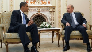 Former U.S. president Barack Obama describes Russian's then-prime minister Vladimir Putin as 'physically unremarkable' after this July 2009 meeting in Moscow. (AFP)