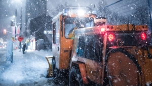 Sidewalk plow at work during a snowstorm in Ottawa, Ont. (Photo by Marc-Olivier Jodoin of Unsplash)