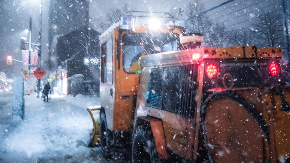 Snowplow on sidewalk in Ottawa