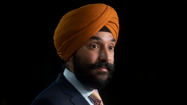 Innovation, Science and Industry Minister Navdeep Bains listens to a reporters question during a news conference Tuesday November 17, 2020 in Ottawa. THE CANADIAN PRESS/Adrian Wyld