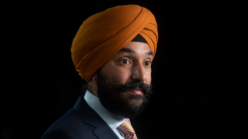Navdeep Bains listens to a reporters question during a news conference Tuesday November 17, 2020 in Ottawa. THE CANADIAN PRESS/Adrian Wyld
