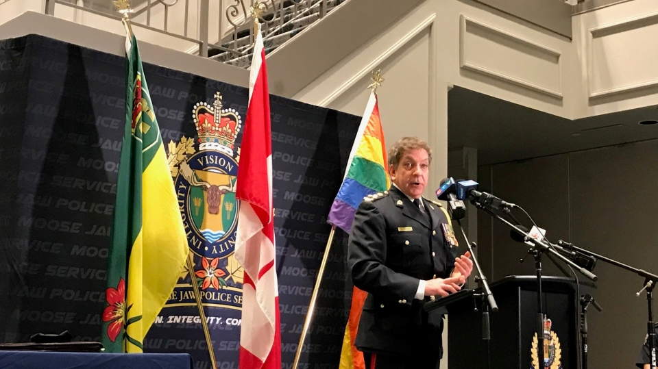 On Tuesday, members of the police service and members of Moose Jaw Pride gathered for the apology, signing a letter of commitment to work together going forward. Chief Rick Bourassa is pictured speaking. (CTV News)