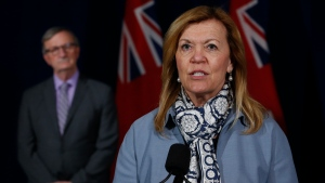 Ontario Chief Medical Officer of Health Dr. David Williams looks on as Ontario Health Minister Christine Elliott speaks at Queen's Park in Toronto on Thursday, June 18, 2020. THE CANADIAN PRESS/Jack Boland-POOL