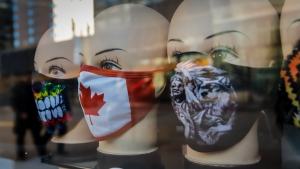 A display of masks in shop window in downtown Calgary, Alta., Friday, Oct. 30, 2020, amid a worldwide COVID-19 pandemic. THE CANADIAN PRESS/Jeff McIntosh
