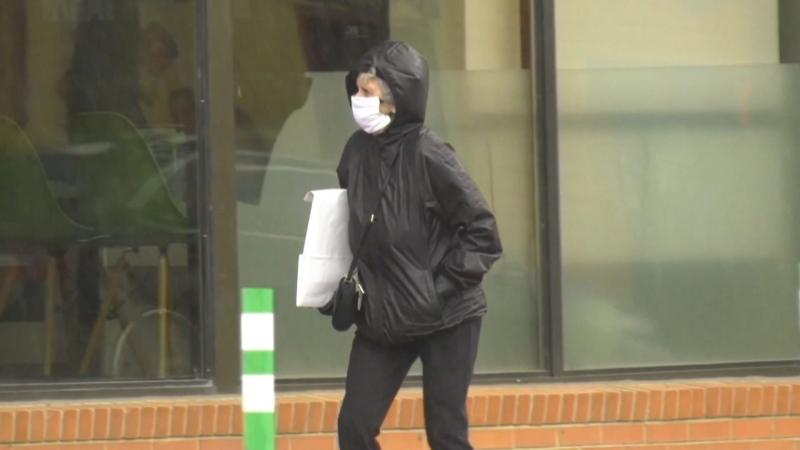 A woman wearing a mask. (file)