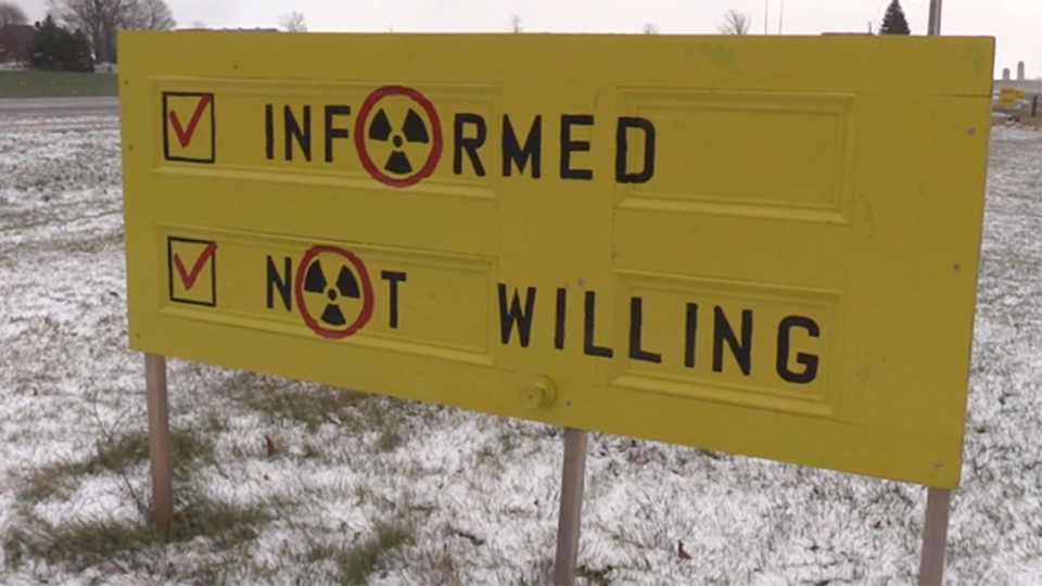 Sign reading, informed, not willing