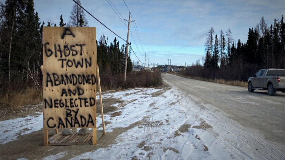 A sign hangs outside Neskantaga First Nation, where a boil-water advisory has lingered for 25 years.