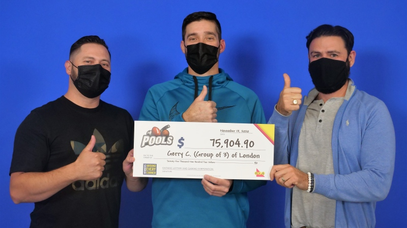 Gerry Cordeiro, Marco De Melo and Peter Almeida of London, Ont. pick up their winnings. (Source: OLG)