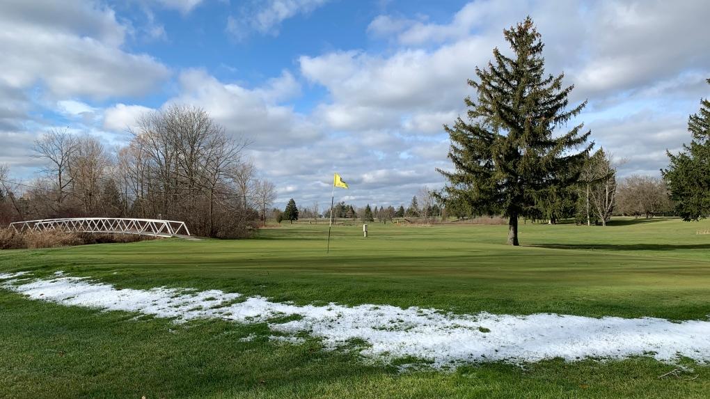 Snow near a golf course green