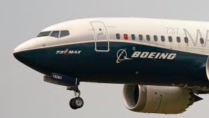 FILE - In this Sept. 30, 2020, file photo, a Boeing 737 Max jet, piloted by Federal Aviation Administration Chief Steve Dickson, prepares to land at Boeing Field following a test flight in Seattle. (AP Photo/Elaine Thompson, File)