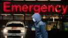 A person wears a protective face mask to help prevent the spread of COVID-19 as they walk past the emergency department of the Vancouver General Hospital in Vancouver Wednesday, November 18, 2020. THE CANADIAN PRESS/Jonathan Hayward