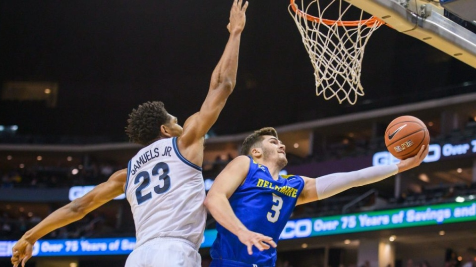 Villanova forward Jermaine Samuels (23) defends Delaware guard Nate Darling (3) during the first half of the Never Forget Tribute Classic NCAA college basketball game, Saturday, Dec. 14, 2019, in Newark, N.J. (Corey Sipkin / AP)