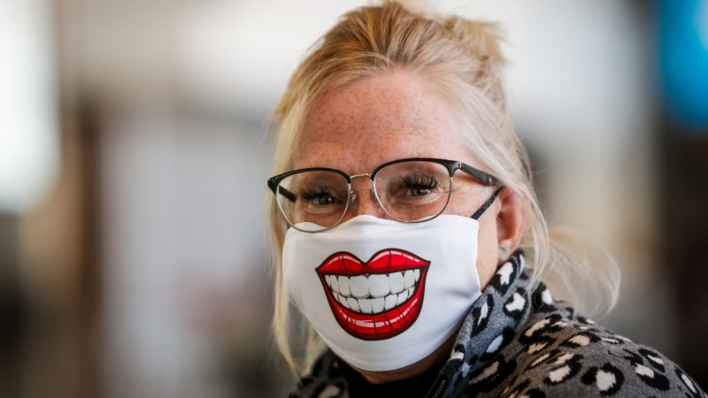 Faith Singh smiles while wearing a mask at the Calgary Airport in Calgary, Alta., Friday, Oct. 30, 2020, amid a worldwide COVID-19 pandemic. THE CANADIAN PRESS/Jeff McIntosh