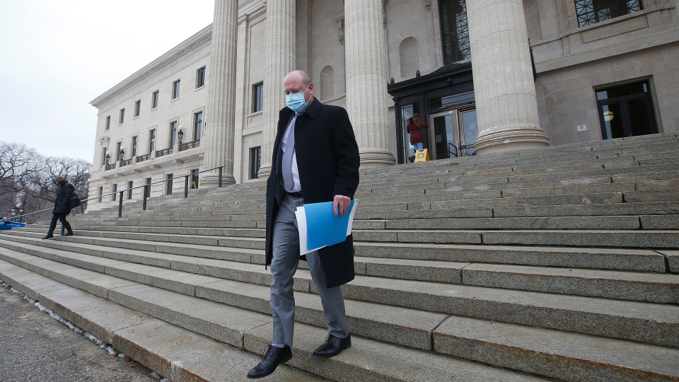 Dr. Brent Roussin, Manitoba chief public health officer, leaves after speaking at the province's latest COVID-19 update at the Manitoba legislature in Winnipeg Friday, October 30, 2020. THE CANADIAN PRESS/John Woods