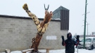 Douglas Lingelbach unveils a new art piece in Fort Qu'appelle on Nov. 19, 2020. The sculpture was created with a chainsaw. (Alison MacKinnon/CTV News)