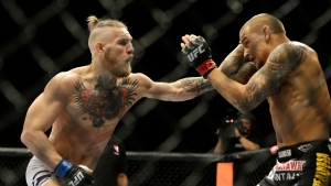 In this Sept. 27, 2014, file photo, Conor McGregor, left, and Dustin Poirier, exchange hits during their mixed martial arts bout in Las Vegas. (AP Photo/John Locher, File)