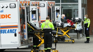 FILE - Paramedics transport an elderly man to the hospitals emergency department during the COVID-19 pandemic in Mississauga, Ont., on Thursday, November 19, 2020. THE CANADIAN PRESS/Nathan Denette