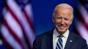 In this Nov. 10, 2020, file photo President-elect Joe Biden smiles as he speaks at The Queen theatre in Wilmington, Del. (AP Photo/Carolyn Kaster, File)