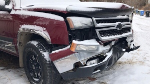 Damage to Barry Bigelow's pickup truck following a Nov. 2 crash involving a stolen car on Barlow Trail
