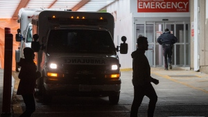 People pass by a hospital emergency in Toronto on Wednesday, November 18, 2020. THE CANADIAN PRESS/Frank Gunn