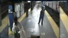 A woman sustained only minor injuries after being pushed off a New York City subway platform just as a train was entering the station.