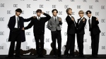 """Members of South Korean K-pop band BTS pose for photographers during a press conference to introduce their new album """"BE"""" in Seoul, South Korea, Friday, Nov. 20, 2020. (AP Photo/Lee Jin-man)"""
