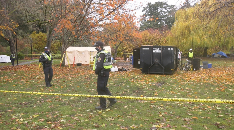 Police and Victoria bylaw officers attend to area where homeless people have been sheltering in Beacon Hill Park. (CTV News)