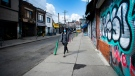 A lone person walks past closed businesses in Kensington Market in Toronto on Wednesday, April 15, 2020. As the federal government begins accepting applications for the Canada Emergency Wage Subsidy to soften the economic blow of the COVID-19 outbreak, many business owners wonder if their own wages are covered. THE CANADIAN PRESS/Nathan Denette