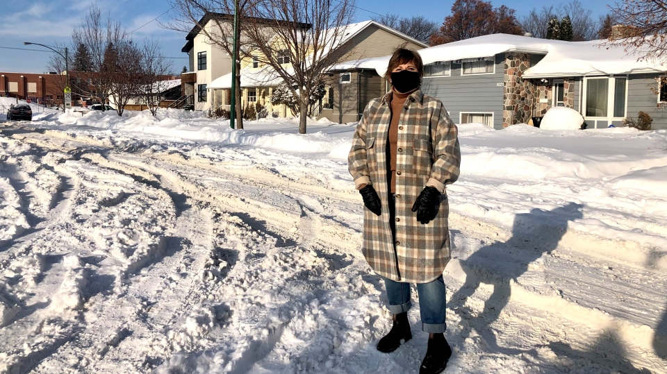 Brenda Sereda stands in the deep snow on her block of 4th St. E. Saskatoon (Kaitlyn Schropp)
