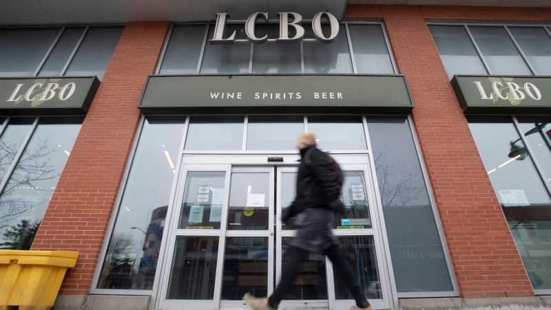 A person walks past an LCBO location on Thursday March 19, 2020. THE CANADIAN PRESS/Adrian Wyld
