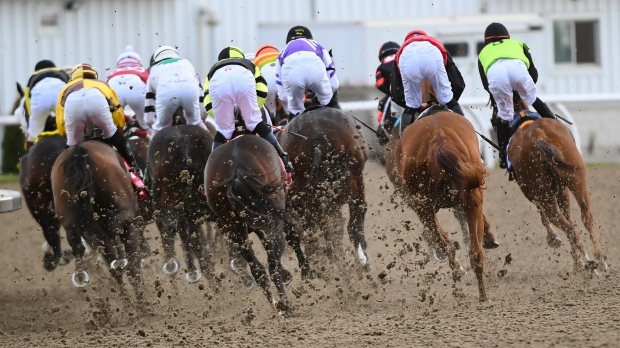 Horses kick up dirt as jockeys ride on the first corner during the running of the 161st Queen's Plate at Woodbine Racetrack in Toronto on Saturday, September 12, 2020. For the first time this year, champion mare Starship Jubilee will have home-track advantage when she lines up in the starter's gate. THE CANADIAN PRESS/Nathan Denette