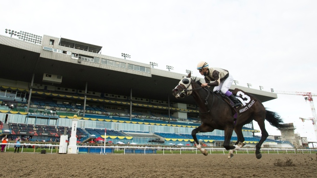 Mighty Heart with jockey Daisuke Fukumoto rides to victory during the running of the 161st Queen's Plate at Woodbine Racetrack in Toronto on Saturday, September 12, 2020. THE CANADIAN PRESS/Nathan Denette