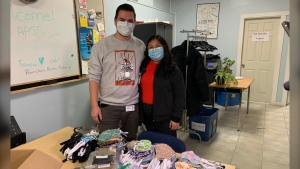 Aids Programs South Saskatchewan has gathered thousands of donated masks for its clients. Cole Woytiuk (left) helped organize the campaign. (Marc Smith/CTV News)