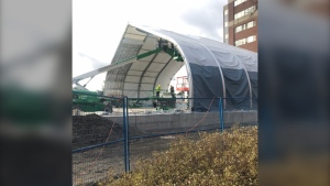 Work continues on a temporary hospital unit in the parking lot at the Ottawa Hospital Civic Campus. (John Crupi/CTV News Ottawa)