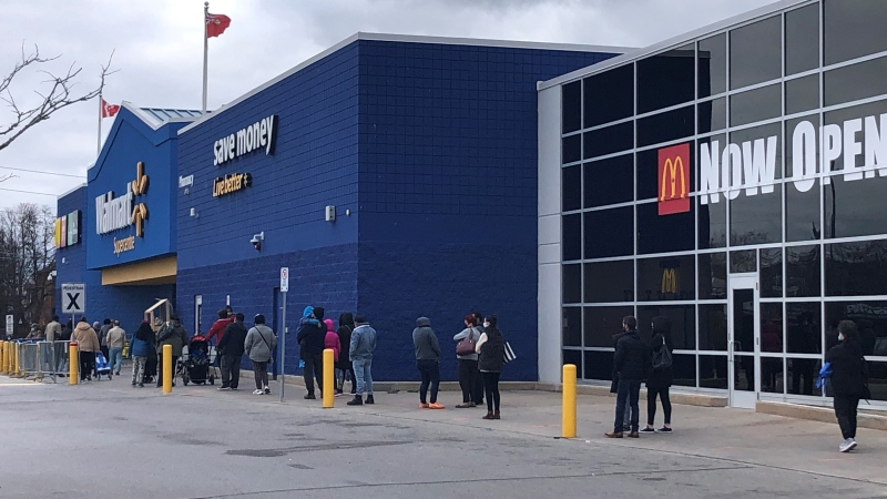Lineups form outside a Walmart at Jane St. and St. Clair Ave. in Toronto ahead of the city and Peel Region going into a lockdown on Monday. (Courtesy: Corey Baird)