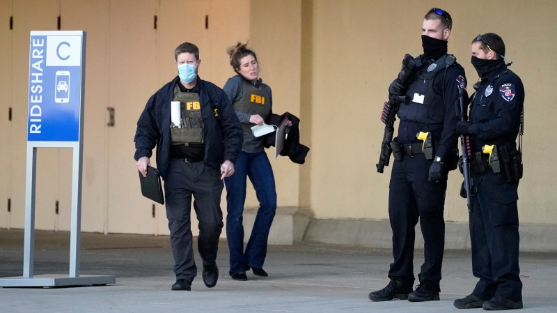 Police and FBI agents investigate a shooting at the Mayfair Mall, Friday, Nov. 20, 2020, in Wauwatosa, Wis. (AP Photo/Nam Y. Huh)