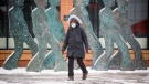 A pedestrian wearing a mask crosses a street in Calgary, Alta., Thursday, Nov. 19, 2020, amid a worldwide COVID-19 pandemic. THE CANADIAN PRESS/Jeff McIntosh