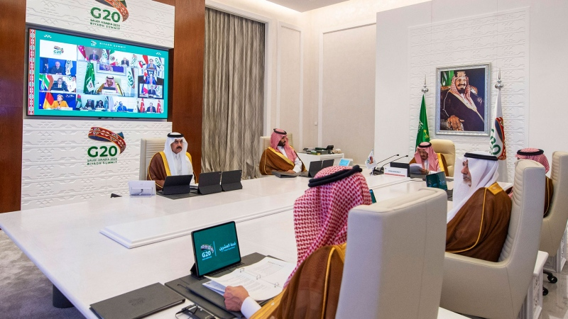 In this handout image provided by G20 Riyadh Summit, Saudi King Salman, top right, gives his opening remarks at a virtual G20 summit hosted by Saudi Arabia and held over video conference amid the COVID-19 pandemic, in Riyadh, Saudi Arabia, Saturday, Nov. 21, 2020. (G20 Riyadh Summit via AP)