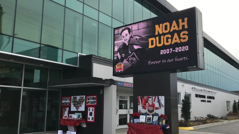 Pictures, candles and memories currently sit outside of Memorial Gardens in honour of Noah Dugas. Nov. 22/20 (Alana Pickrell/CTV News Northern Ontario)