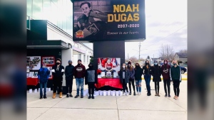 Photo taken at a vigil for Noah Dugas Saturday night at Memorial Gardens. Nov. 21/20 (Photo courtesy of Erin Breadmore)