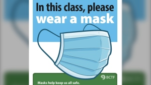 The BCTF has created a new poster for teachers to put in classrooms that reads: In this class, please wear masks. (@bctf/Twitter)