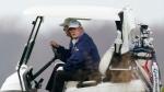 U.S. President Donald Trump drives a golf cart as he golfs at Trump National Golf Club in Sterling, Va., Sunday, Nov. 22, 2020. (AP / Manuel Balce Ceneta)