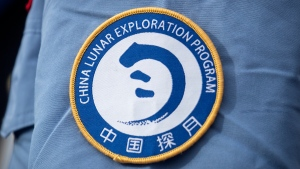 A patch for the China Lunar Exploration Program is displayed on the uniform of a worker at the Wenchang Space Launch Site in Wenchang in southern China's Hainan province, Monday, Nov. 23, 2020. (AP Photo/Mark Schiefelbein)
