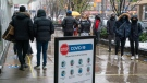 Crowds of people line up outside an electronics store in Toronto on Sunday November 22, 2020. The region is heading back into lockdown on Monday. THE CANADIAN PRESS/Frank Gunn