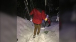 North Shore Rescue team member kicks steps into a snow-covered trail for a hiker who got lost on Nov. 22, 2020.