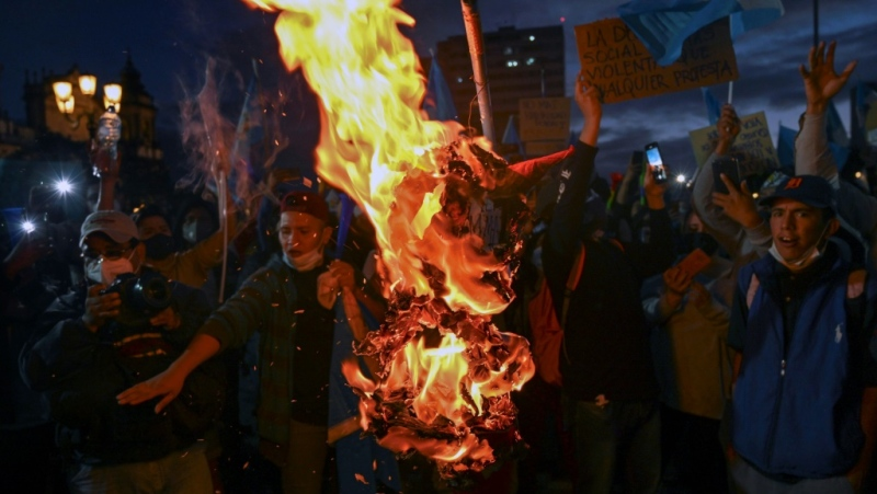 Demonstrators burn an effigy representing Guatemalan President Alejandro Giammattei during a protest demanding his resignation. (AFP)